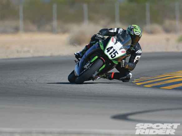 146-1305-05-o+2012-kawasaki_ninja-650+turn-action-shot